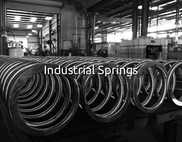 Industrial springs sitting in a warehouse.