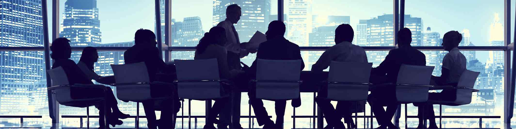 Businesspeople at a conference table in an office building.